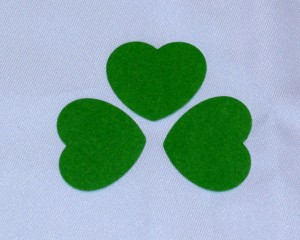 Punch or cut hearts to create shamrock shapes
