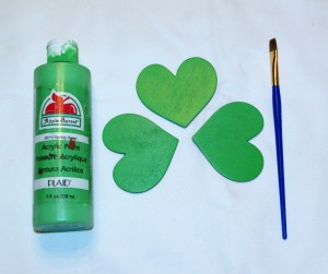 Paint each heart the desired shade of green for your wooden shamrock