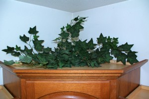 Simple Tips For Decorating Your Cabinet Tops -Add vine for depth