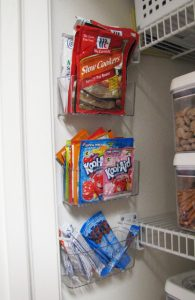 clear-pockets-mounted-to-the-wall-for-food-and-pantry-organization